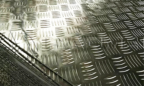 A pile of checker plates aluminium 2